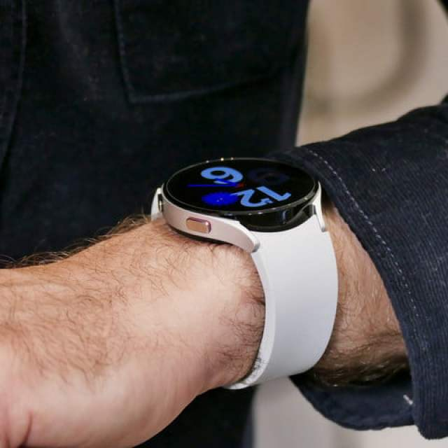 Galaxy Watch 4 in white on the wrist.