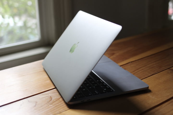 MacBook Pro on a wood table.