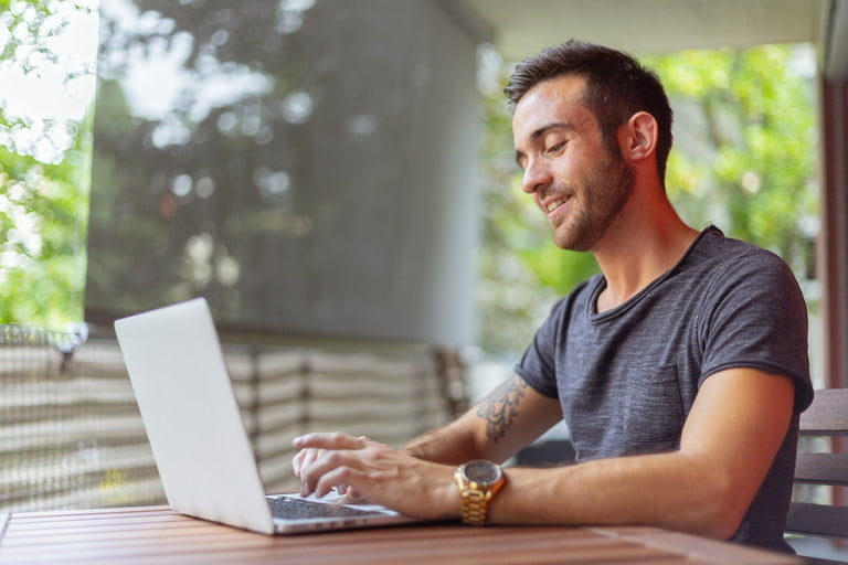 9-steps-for-improving-the-quality-of-video-calls-man-on-laptop