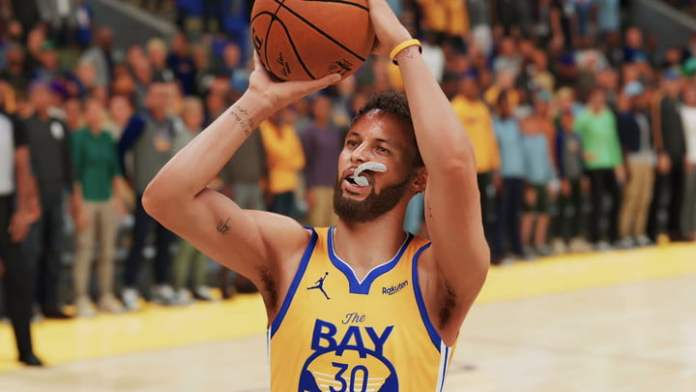 A basketball man is about to shoot the ball.