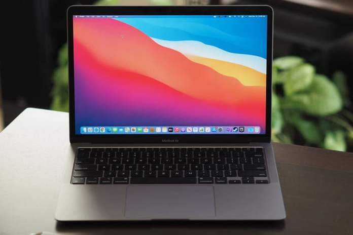 The M1-powered Macbook Air, open on a table.