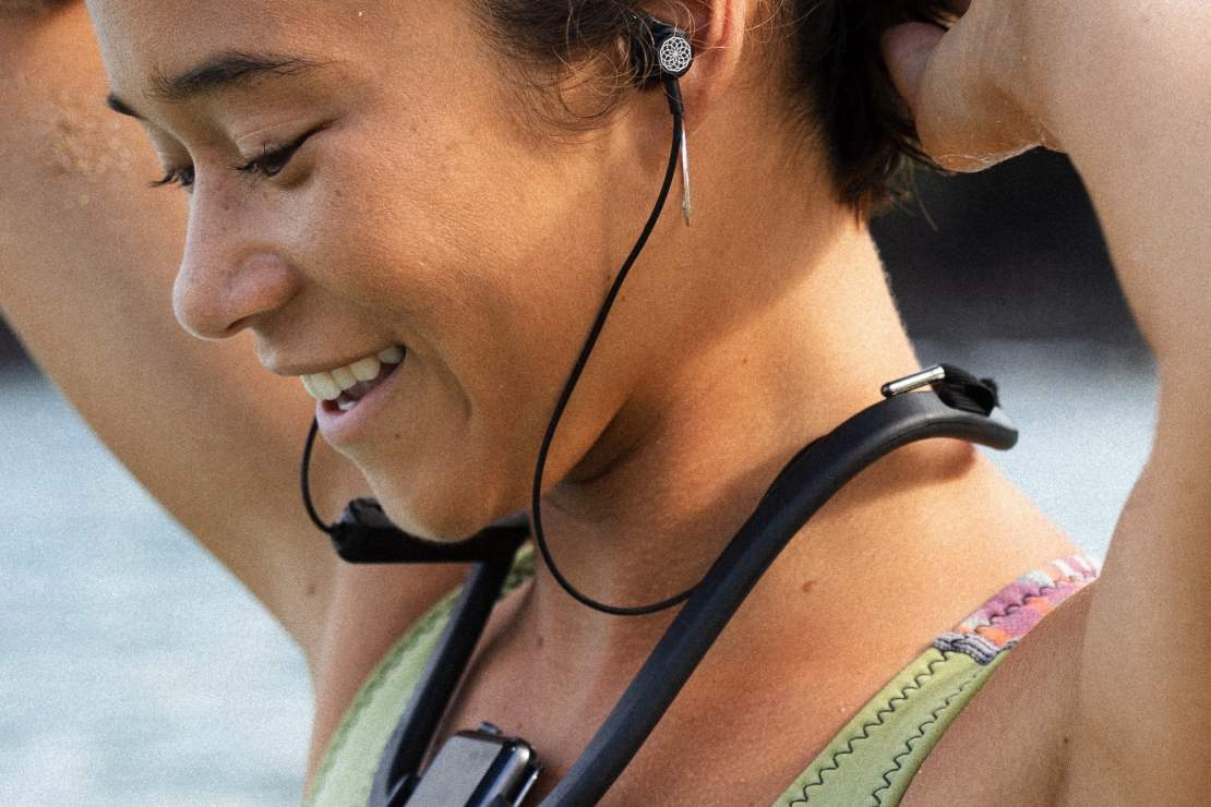 Woman wearing SoundSwell's Smartwatch Series Bluetooth earbuds.