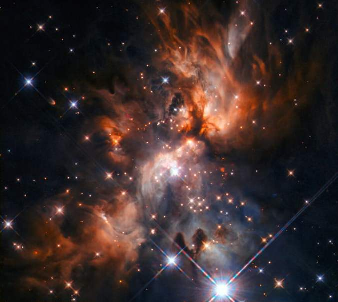 Image from the NASA/ESA Hubble Space Telescope features AFGL 5180, a beautiful stellar nursery located in the constellation of Gemini.