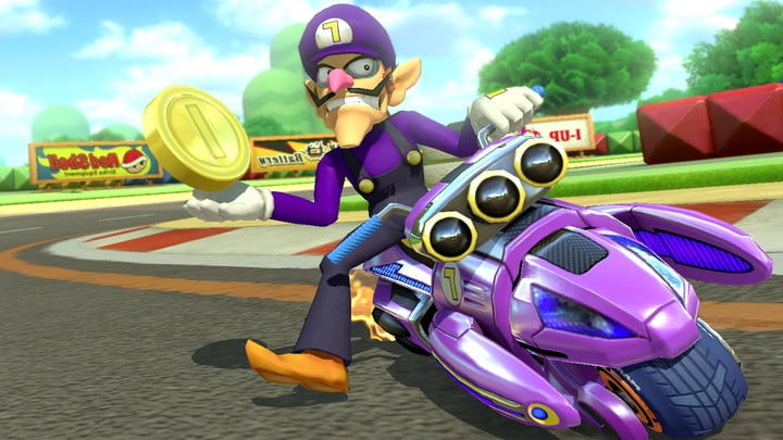 Waluigi rides a kart and holds a coin in Mario Kart 8.