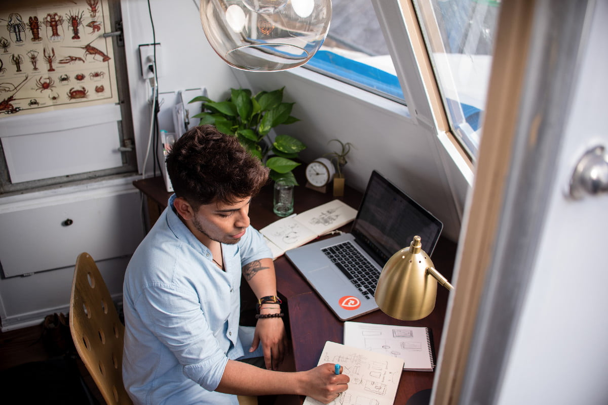 man working at a desk at home