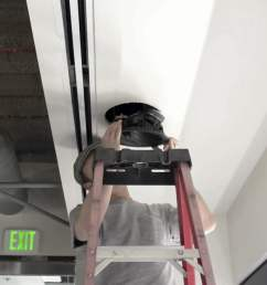 inserting into ceiling install dolby atmos ceiling speakers [ 1359 x 906 Pixel ]