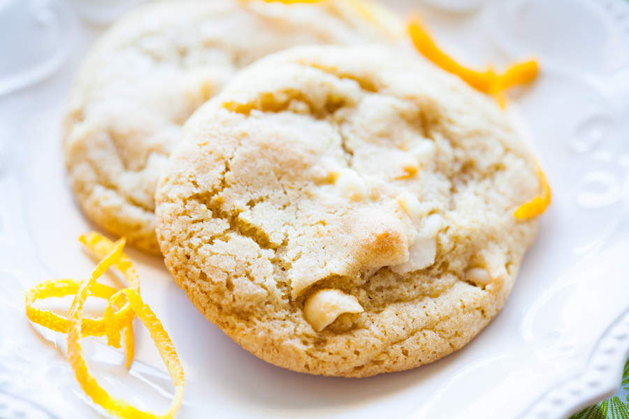 Orange White Chocolate Macadamia Nut Cookies are a new twist on the classic cookie we all love so well! With orange peel and orange essential oil (or extract), these cookies will become a favorite! Macadamia nut cookies, white chocolate cookies, orange cookies, Christmas cookies