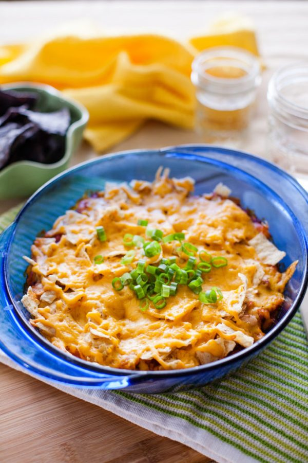 Mix up and bake this family-pleasing Mexican Casserole in just over thirty minutes! Full of tasty meat and beans, and topped with chips and cheese, it's perfect for any night of the week!