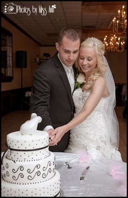 couple-cutting-their-wedding-cake-saint-marys-cultural-center-wedding-photos-by-miss-ann