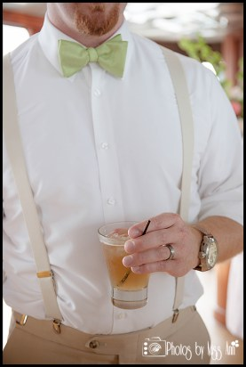 groom-with-lime-green-bowtie-and-suspenders-infinity-yacht-wedding-iceland-wedding-photographer-photos-by-miss-ann