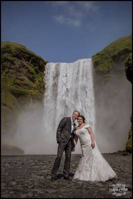 iceland-wedding-bride-and-groom-and-skogafoss-waterfall