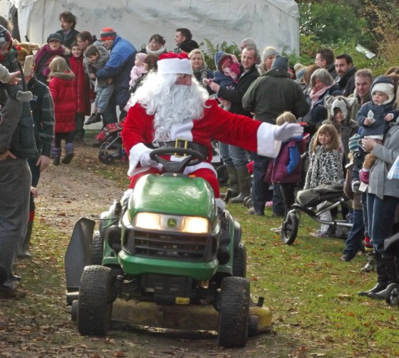 father-christmas-arriving-on-his-lawnmower-fairhaven-garden