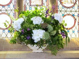 Mantle vase full of Vintage style Summer Wedding Flowers