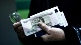 Man carrying Russian roubles - file pic