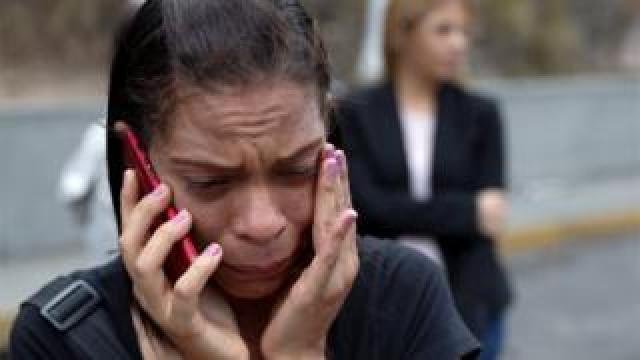 A relative of an inmate cries outside a detention centre of the Bolivarian National Intelligence Service (SEBIN), where a riot occurred, according to relatives, in Caracas, Venezuela May 16, 2018.