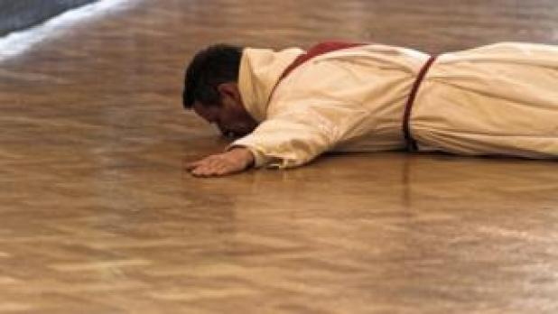 Philip Mulryne prostrate as he was ordained a priest in Dublin on Saturday