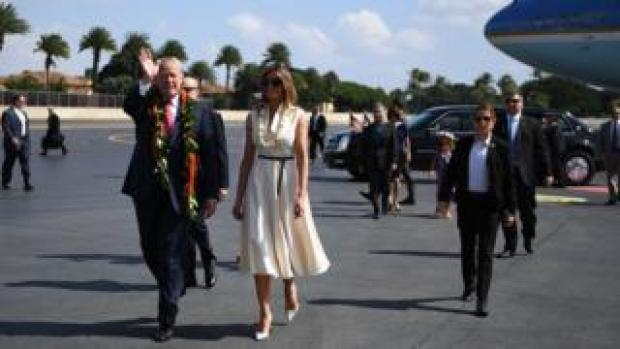 US President Donald Trump and First Lady Melania Trump arrive at Joint Base Pearl Harbor-Hickam in Hawaii on November 3, 2017