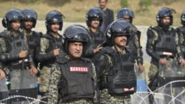 """Pakistani paramilitary troopers purchase positions shut to the supporters of religous group """"Tehrik Labayk Ya Rasool Allah (TLYRA)"""" all over a stutter in Islamabad, Pakistan, 26 November 2017."""