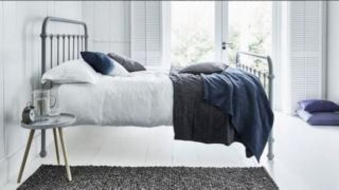 Feather & Black bed