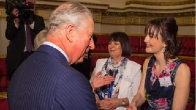 The Prince of Wales meets Royal College of Nursing Student Nurse of the Year Zoe Butler (right) and Elaine Perry of Macmillan Cancer Support
