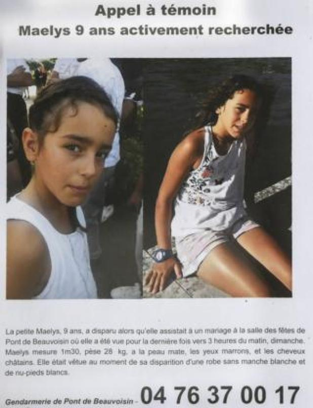 A photo taken on 28 August 2017 shows an appeal for witnesses poster for Maëlys, a nine-year-old girl who disappeared during a wedding party on 26-27 August in Pont-de-Beauvoisin, eastern France