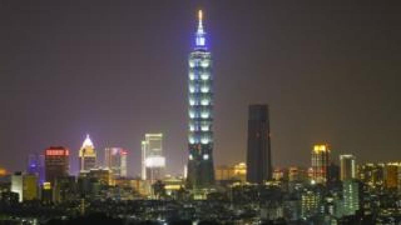 A view of the skyscaper Taipei 101 with lights-on before the Earth Hour in Taipei, Taiwan