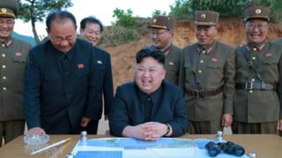 North Korean leader Kim Jong-un reacts during test launch in undated photo released by North Korea's Korean Central News Agency on May 15, 2017