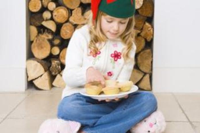 Girl with a plate of mince pies