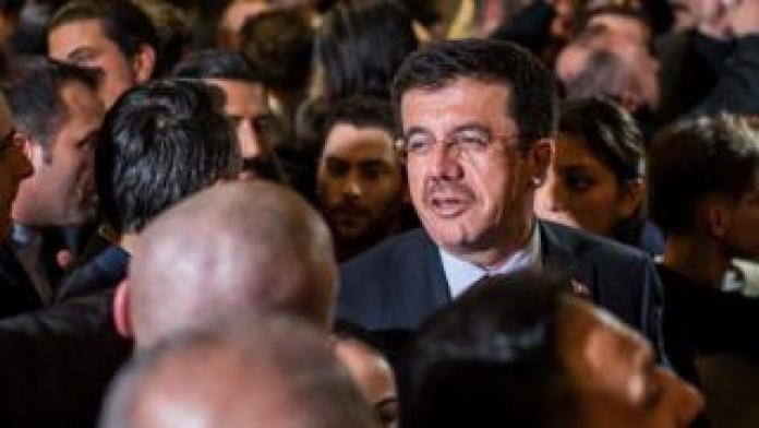 Turkish Economy Minister Nihat Zeybekci talks to Turkish people in Cologne, Germany on 5 March.