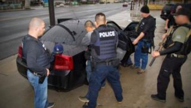 US Immigration officers detain a suspect in Los Angeles, California, 7/2/17