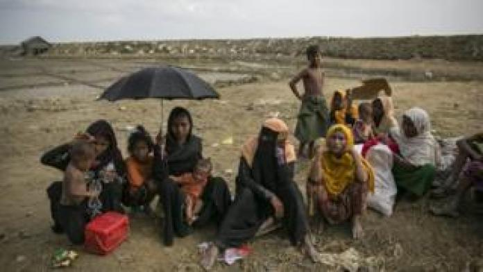 Rohingya refugees resting after crossing into Bangladesh