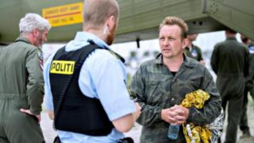 Submarine owner and inventor Peter Madsen speaks to police