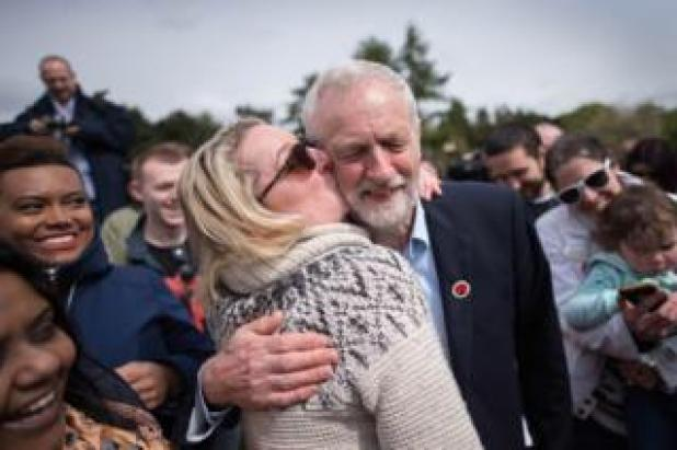 Labour leader Jeremy Corbyn is kissed by a supporter at a rally in Harlow, Essex.
