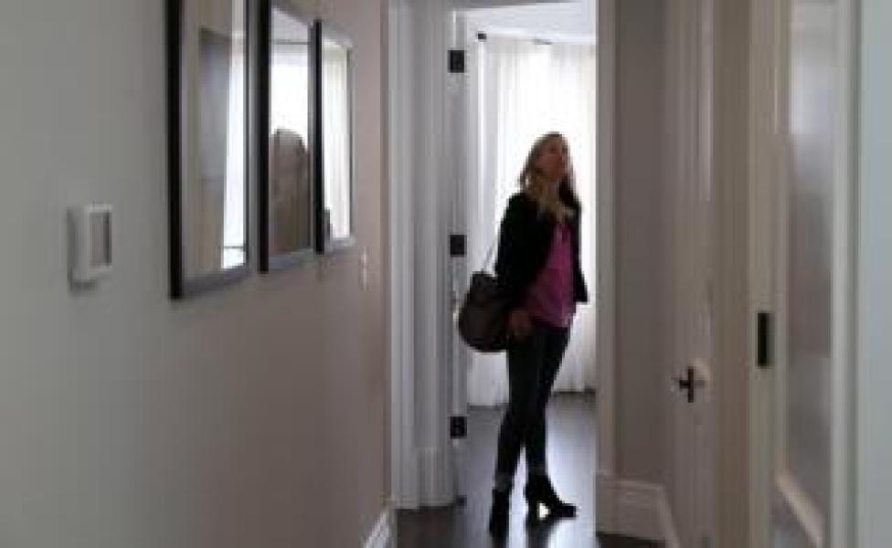 woman views house