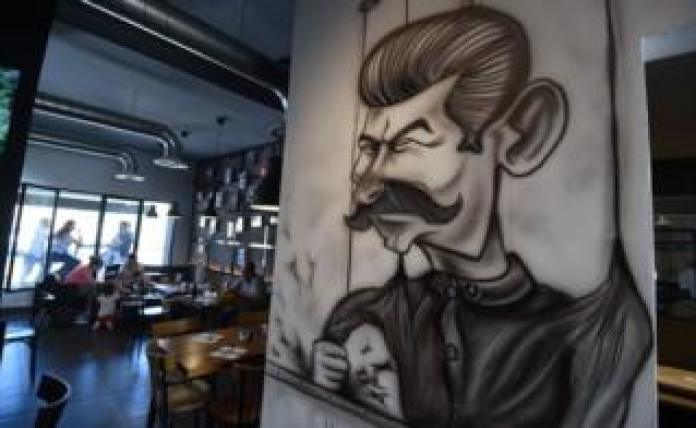 Cartoons adorn the walls of restaurant