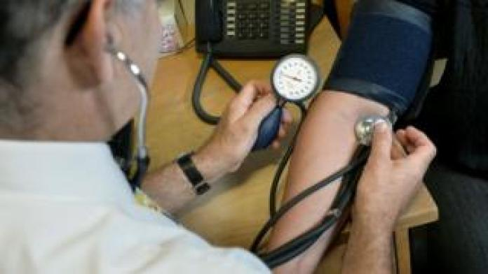 Doctor checks blood