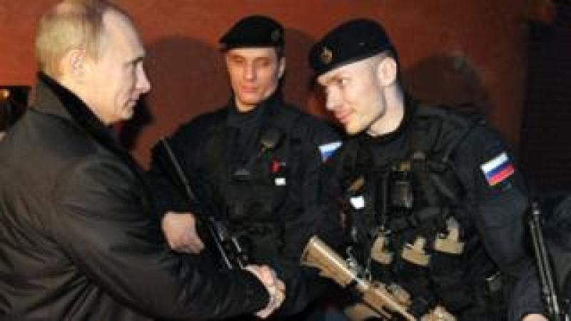 President Putin (L) with FSB special forces in Chechnya, 20 Dec 11