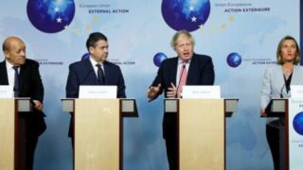 Boris Johnson speaks at a joint news conference in Brussels with French Foreign Minister Jean-Yves Le Drian (L), Germany's Sigmar Gabriel (2L) and EU foreign policy chief Federica Mogherini (R)