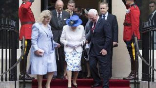 Britain's Queen Elizabeth II (C) leaves Canada House with Governor General of Canada David Johnston (2-R) and Canadian High Commissioner to the United Kingdom Janice Charette (2-L) in Central London, Britain