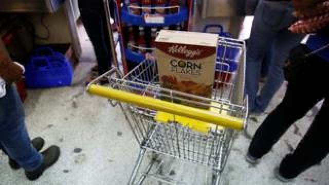 A box of Kellogg's Corn Flakes on a shopping trolley inside a shop in Caracas, Venezuela May 15, 2018