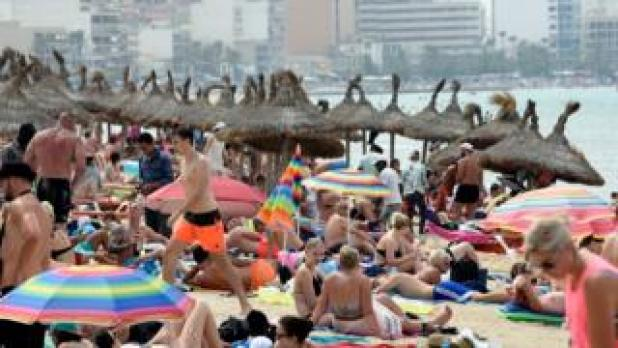 A view of Palma Beach stuffed full of tourists and locals in Palma Majorca, the Balearic islands, Spain, 08 July 2017.