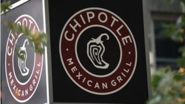 A sign marks the location of a Chipotle restaurant on October 25, 2017 in Chicago, Illinois