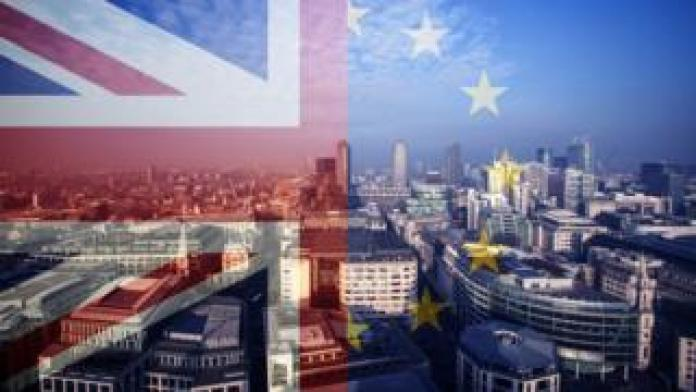 UK and EU flags over City of London