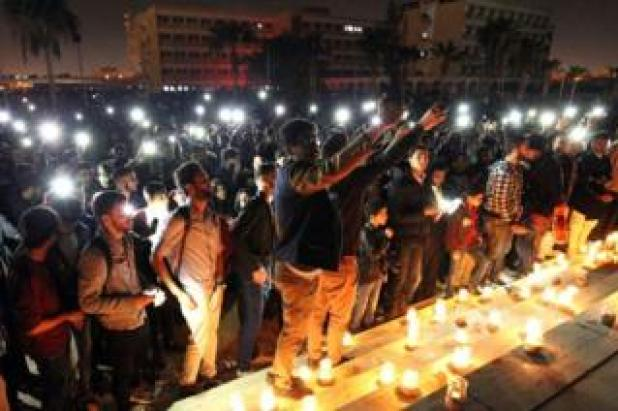 Libyans attend a candlelit concert marking 'Earth Hour' in the eastern coastal city of Benghazi on March 25, 2017, as iconic landmarks and skylines are plunged into darkness as the 'Earth Hour' switch-off of lights around the world got under way to raise awareness of climate change.