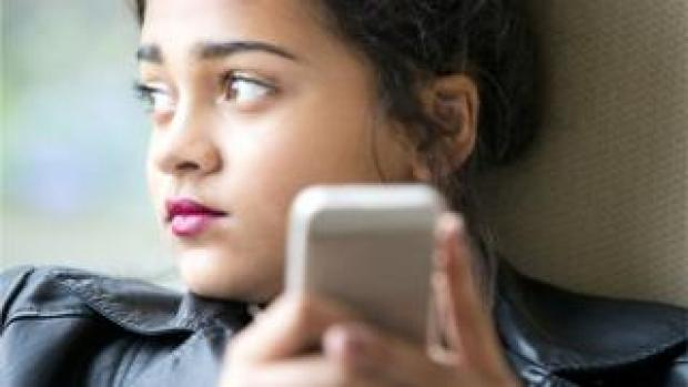 File picture of young person using mobile phone