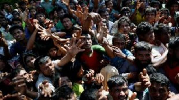 Rohingya stretch their hands to get aid supplies in Cox's Bazar, Bangladesh. Photo: 16 September 2017