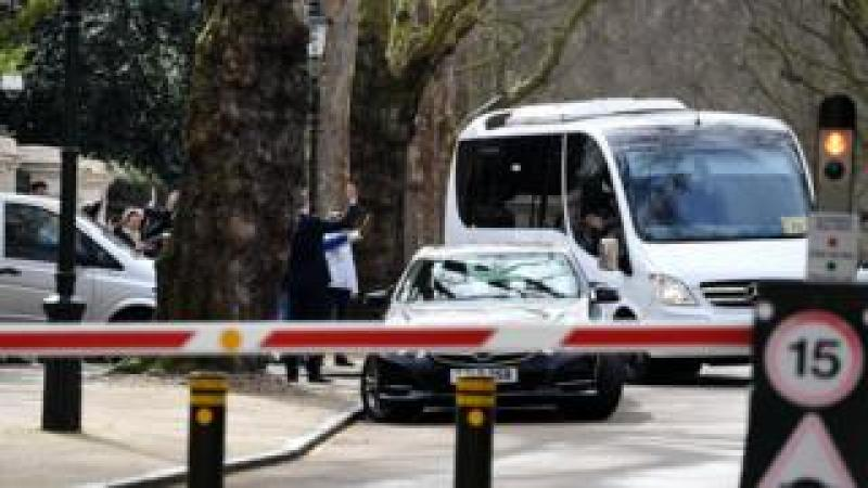 Russian diplomats and family members leave in a bus from the Russian Embassy