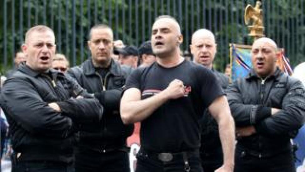 Far-right leader Serge Ayoub (C) with fellow activists in Paris in 2011