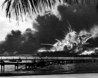 he USS Shaw explodes during the Japanese raid on Pearl Harbor December 7, 1941