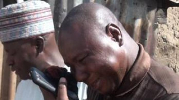 A man wipes away a tear after the girls were released in Dapchi